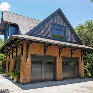 Example of a mid-sized arts and crafts brown two-story wood exterior home design in Wilmington with a shingle roof