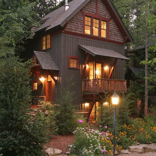 Mid-sized mountain style three-story wood gable roof photo in Other