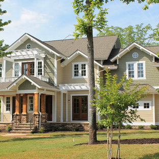 Large elegant multicolored two-story mixed siding exterior home photo in Richmond with a shingle roof
