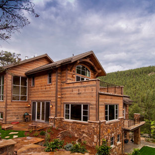Inspiration for a rustic wood exterior home remodel in Salt Lake City