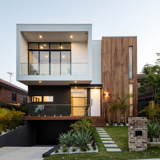 This is an example of a white contemporary two floor detached house in Sydney with mixed cladding and a flat roof.