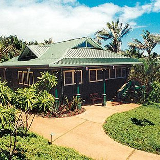 Example of an island style exterior home design in Hawaii