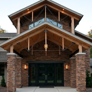 Inspiration for a large industrial brown two-story exterior home remodel in Other with a shingle roof