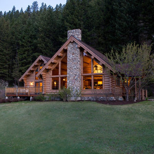 Mountain style one-story wood exterior home photo in Other
