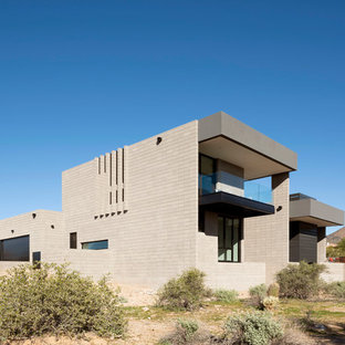 Example of a mid-sized minimalist beige two-story concrete exterior home design in Phoenix