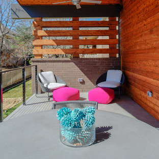 Mid-sized modern multicolored split-level brick house exterior idea in Dallas with a shed roof and a metal roof