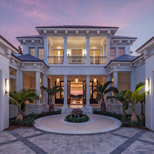 Example of an island style white two-story exterior home design in Miami