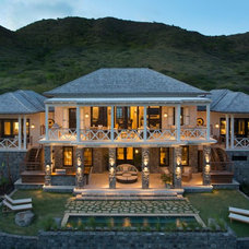 Tropical Exterior by Herlong & Associates Architects + Interiors