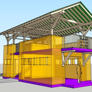 Diseño de fachada amarilla, exótica, pequeña, de dos plantas, con revestimiento de estuco y tejado de un solo tendido