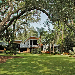 Example of an island style exterior home design in Orlando