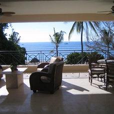 Tropical Exterior by Julie Dreiling Interiors, LLC