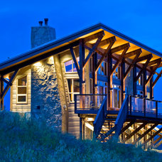 Rustic Exterior by Sticks and Stones Design Group Inc