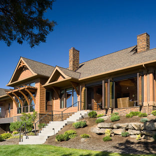 Example of a mountain style wood exterior home design in Portland