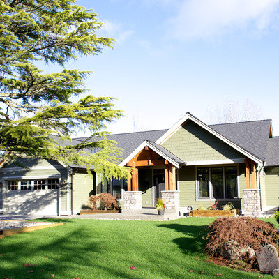 Inspiration for a timeless green exterior home remodel in Vancouver