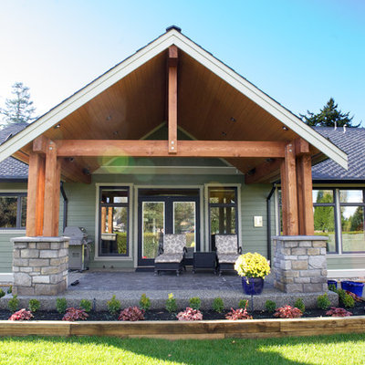 Example of a classic green exterior home design in Vancouver