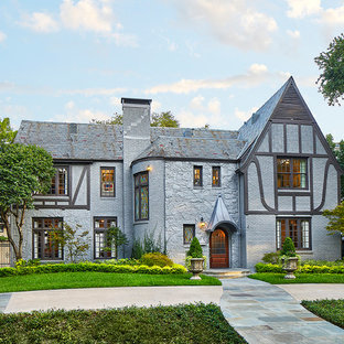 Mid-sized elegant gray two-story exterior home photo in Dallas with a shingle roof