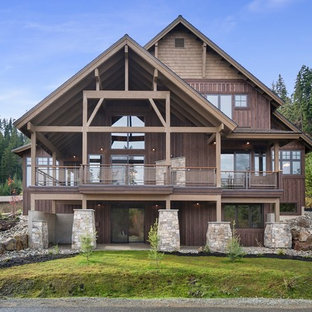 Inspiration for a rustic brown three-story wood exterior home remodel in Seattle