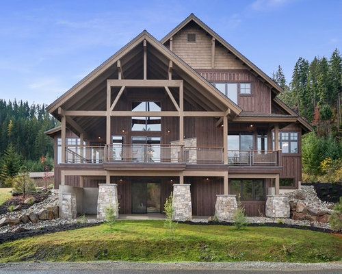 inspiration for a rustic brown three story wood gable roof remodel in seattle