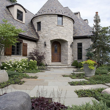 Tumbled Stone and Stucco French Provincial with Turreted Front Entry