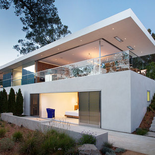 Inspiration for a modern white two-story flat roof remodel in San Francisco