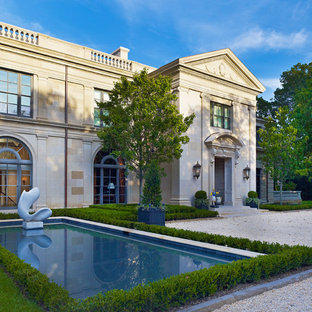 Huge elegant two-story stone exterior home photo in Dallas