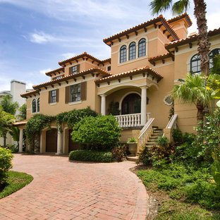 Example of a large tuscan exterior home design in Tampa