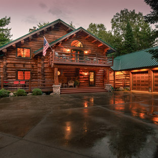 Mountain style brown two-story wood gable roof photo in Other with a metal roof