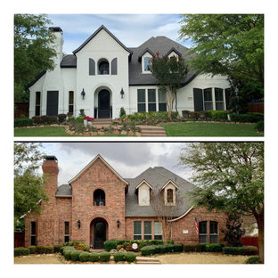 Expansive transitional two-storey white house exterior in Dallas with a shingle roof.