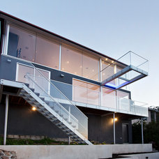 Contemporary Exterior by Jetton Construction, Inc.
