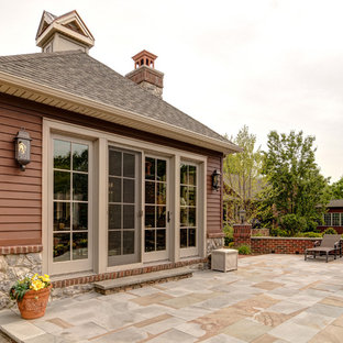 Photo of a traditional exterior in Other with stone veneer.