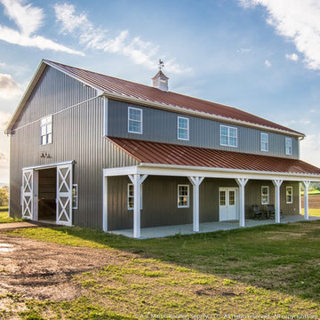 Two Story Pole Barn with Colonial Red ABSeam Roof and Charcaol ABM Panel Sides