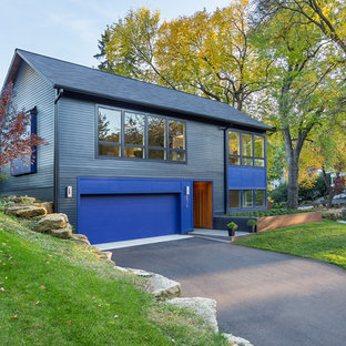 Example of a transitional multicolored two-story exterior home design in Minneapolis with a shingle roof