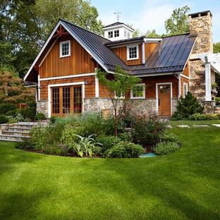 Elegant exterior home photo in New York with a metal roof