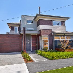 Idee per la facciata di una casa contemporanea con rivestimento in mattoni