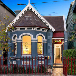 Victorian one-storey blue house exterior in Sydney with a gable roof.