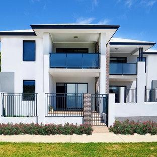 パースの巨大なモダンスタイルのおしゃれな家の外観 (混合材サイディング、青い外壁、アパート・マンション) の写真