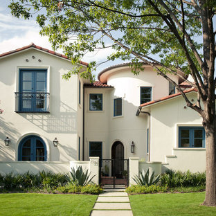 Mid-sized mediterranean beige two-story exterior home idea in Dallas