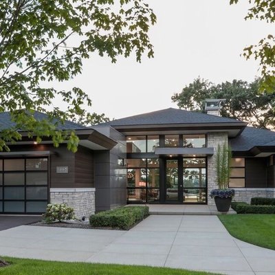 Large modern multicolored two-story mixed siding house exterior idea in Detroit with a hip roof and a shingle roof