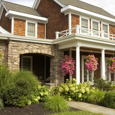 Traditional Exterior by Mari Kirwood Design Associates