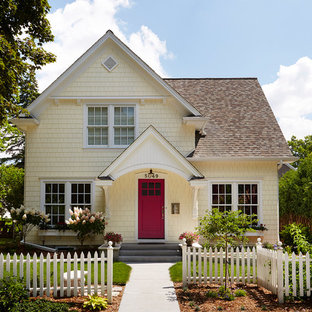 Mid-sized transitional yellow two-story wood gable roof photo in Minneapolis