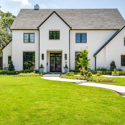 Transitional white two-story exterior home photo in Dallas with a shingle roof