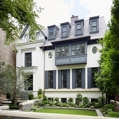 Inspiration for a timeless white three-story gable roof remodel in Chicago