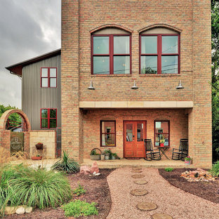 Urban two-story brick exterior home photo in Austin