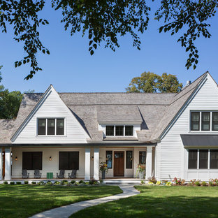 Mid-sized elegant white two-story wood exterior home photo in Minneapolis with a shingle roof