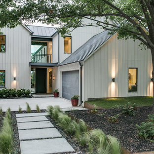 Large transitional white two-story wood gable roof idea in Dallas