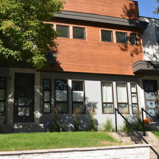 Mid-sized contemporary gray three-story mixed siding exterior home idea in Denver with a mixed material roof