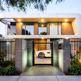 Inspiration for a contemporary two-storey white house exterior in Melbourne with mixed siding and a flat roof.
