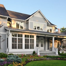 Farmhouse Exterior by Siena Custom Builders, Inc.