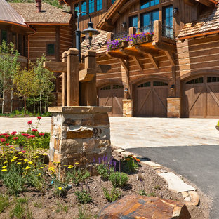 Large mountain style brown three-story wood gable roof photo in Denver