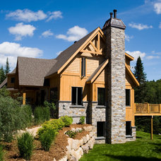 Traditional Exterior by Les Constructions MontagneArt